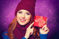 Redhead girl with gift Stock Image