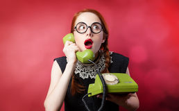 Redhead girl with green phone Royalty Free Stock Image