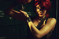Redhead girl with grenade Royalty Free Stock Photos