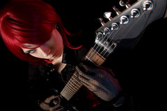 Redhead girl with guitar, high angle view Royalty Free Stock Photo