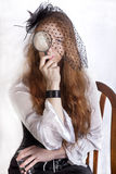 Redhead girl with hand-glass Royalty Free Stock Photo