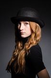 Redhead girl in hat Stock Photography