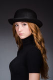 Redhead girl in hat against Royalty Free Stock Image
