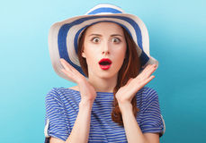 Redhead girl in hat. On blue background Stock Photos