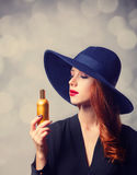 Redhead girl in a hat Stock Image
