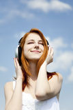 Redhead girl with headphone Royalty Free Stock Photography