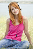 Redhead girl with headphone Royalty Free Stock Photos