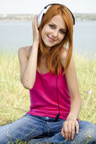 Redhead girl with headphone Stock Photography