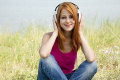 Redhead girl with headphone Royalty Free Stock Photo