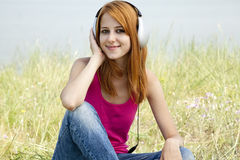 Redhead girl with headphone Royalty Free Stock Images