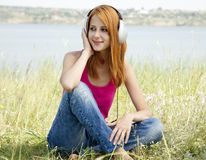 Redhead girl with headphone Stock Photo