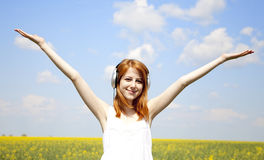 Redhead girl with headphone at field. Stock Image