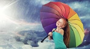 Redhead girl in the heavy rain Royalty Free Stock Images