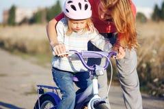 Redhead girl in helmet Stock Image