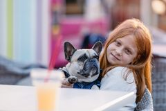 Redhead girl with her dog royalty free stock images