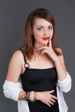 Redhead girl holding finger to her lips Stock Photography