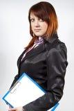 Redhead Girl holding a folder Stock Photos