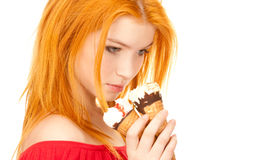 Redhead girl holding ice cream Royalty Free Stock Photo