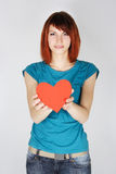 Redhead girl holding red paper hear Royalty Free Stock Photography