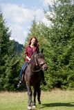 Redhead girl with horse Stock Photo