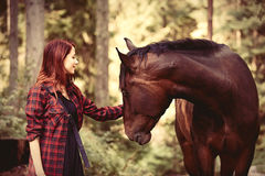 Redhead girl with horse Stock Photography