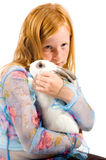 Redhead Girl Is Cuddling With A White Rabbit Royalty Free Stock Photos