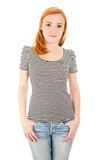 Redhead girl in jeans Stock Images