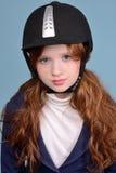Redhead girl jockey. Modest red-haired girl with freckles in a jockey helmet, jockey concept Stock Photo