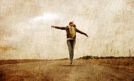 Redhead girl jumpig at outdoor. Stock Image