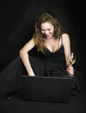 Redhead girl with laptop and glass of wine stock photos