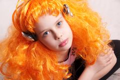 Redhead girl listen to music Royalty Free Stock Photography