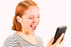 Redhead Girl Looking at Cellphone Royalty Free Stock Photo