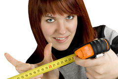 Redhead girl with measuring tool ruler Royalty Free Stock Photo