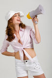 Redhead girl with megaphone Royalty Free Stock Image