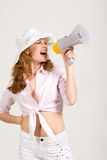 Redhead girl with megaphone over white Stock Images