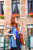 Redhead girl near fence Royalty Free Stock Photography