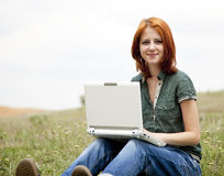 Redhead girl with notebook at outdoor. Royalty Free Stock Image