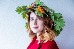 Redhead girl with oak leaves wreath at Germany Unity day Stock Images