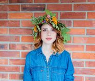 Redhead girl with oak leaves wreath at Germany Unity day Royalty Free Stock Image