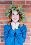 Redhead girl with oak leaves wreath at Germany Unity day Royalty Free Stock Photos