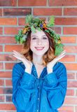 Redhead girl with oak leaves wreath at Germany Unity day Stock Photo