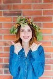 Redhead girl with oak leaves wreath at Germany Unity day Royalty Free Stock Images