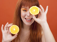 Redhead girl with orange. Glasses royalty free stock photos