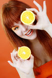 Redhead girl with orange Stock Image