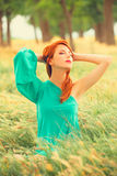 Redhead girl at outdoor Stock Image
