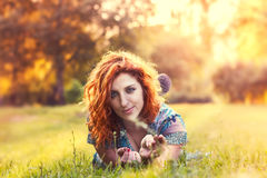 Redhead girl in park royalty free stock photo