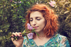 Redhead girl in park Royalty Free Stock Image