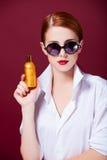 Redhead girl with perfume Royalty Free Stock Photos