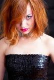 Redhead girl with pink makeup. Closeup of a girls face - red hair and pink makeup Stock Photos