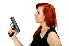 Redhead girl with pistol Royalty Free Stock Image